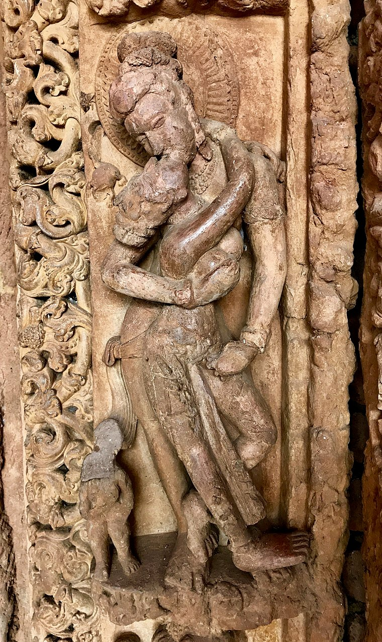 760px-8th_century_couple_embraced_and_mouth_kissing_at_Tivara_Deva_temple,_she_stands_on_his_f...jpg