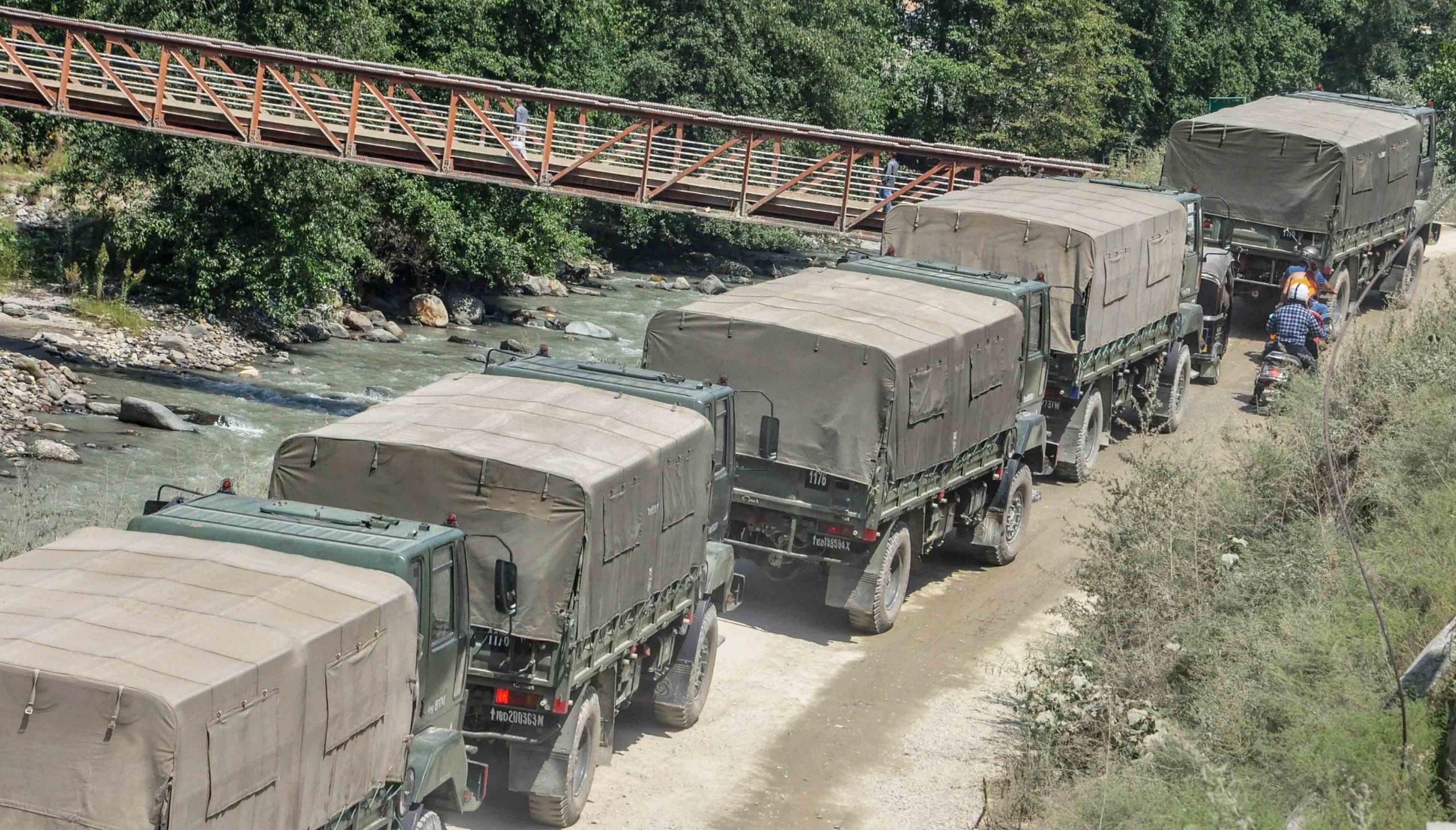Army-trucks-scaled.jpg