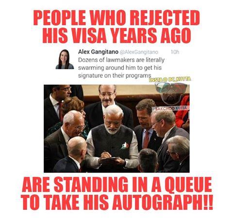 MODI giving autograph to American Senators.jpg
