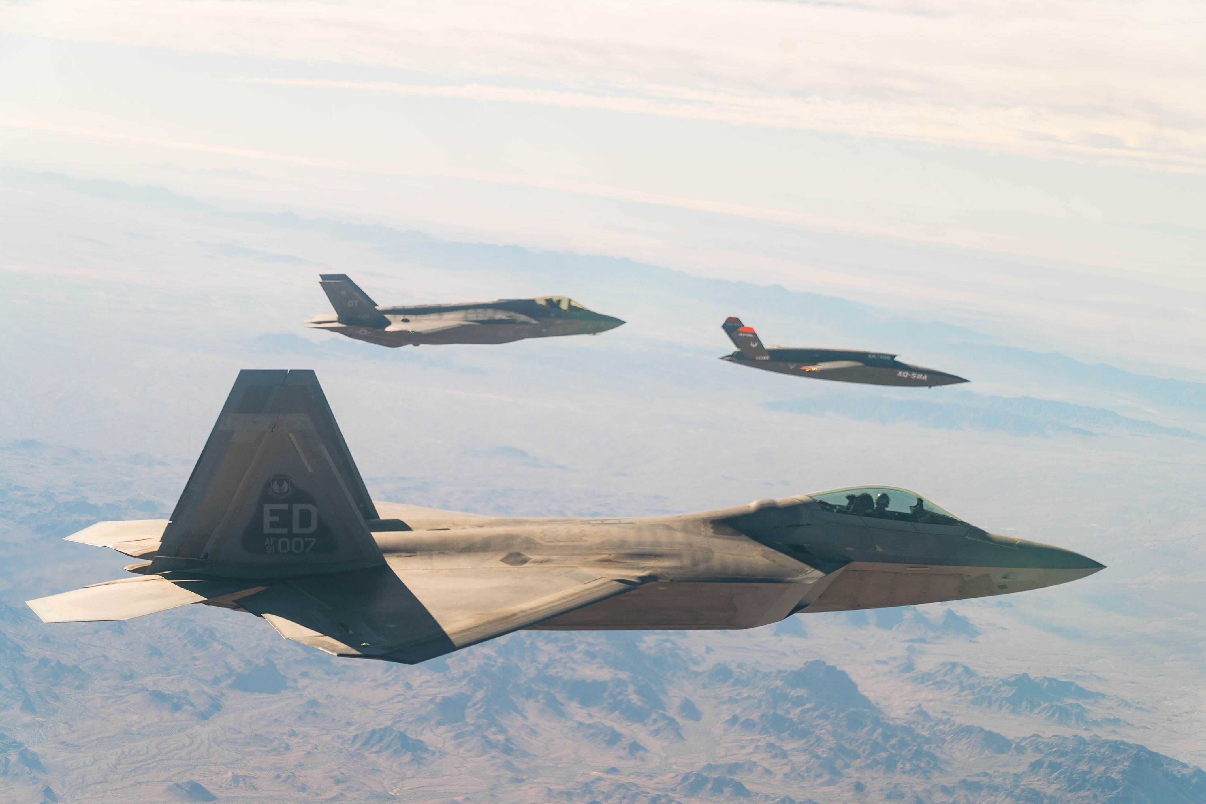 usaf_f-22_raptor_and_f-35a_lightning_ii_fly_in_formation_with_xq-58a_valkyrie.jpg